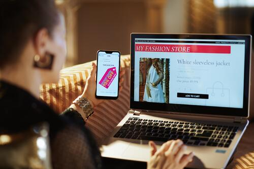 woman enjoying omnichannel shopping experience on laptop and mobile