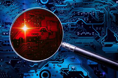 computer board with red magnifying glass