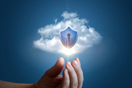 hand with cloud and security shield with keyhole