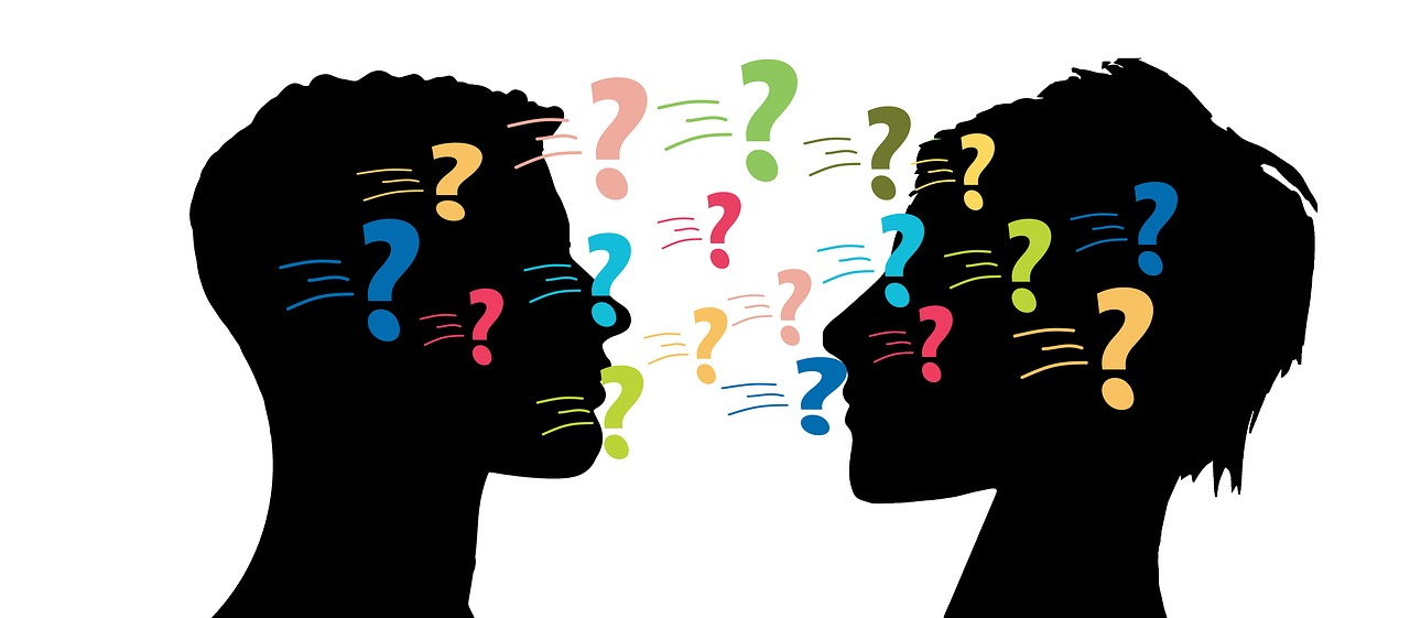 man and woman profile with question marks